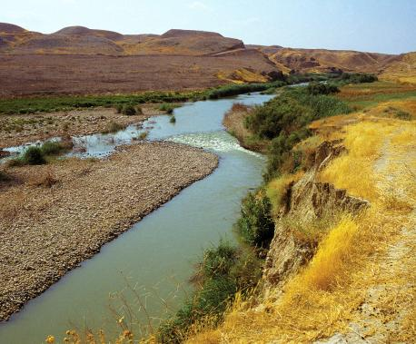 The Jordan River at one of its narrowest points, Jordan, 1992. Source: Ed Kashi/VII.