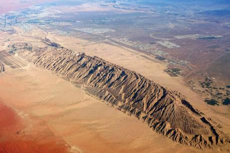 An aerial view of Jebel Hafit, with the city of Al Ain to the north, Abu Dhabi, UAE, 2010. Source: Tom Olliver.